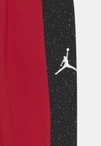 Jordan - AIR SPECKLE PANTS - Tracksuit bottoms - gym red - 2