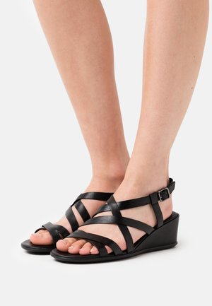 SHAPE - Wedge sandals - black santiago