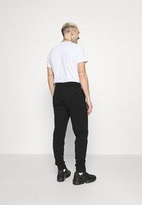 Calvin Klein - SMALL LOGO - Verryttelyhousut - black - 2
