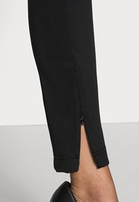 Opus - ELOTTI - Leggings - Trousers - black - 4