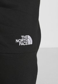 The North Face - JOGGER - Tracksuit bottoms - black - 6