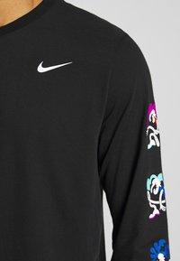 Nike Performance - DRY TEE TOKYO - Koszulka sportowa - black - 6