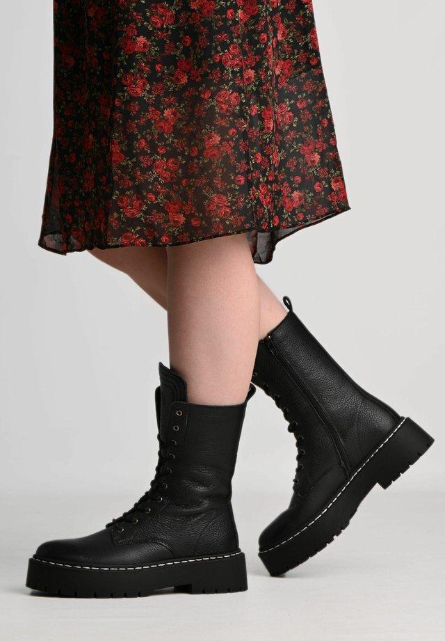 DIANA - Platform ankle boots - black/ white