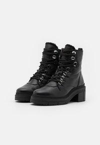Unisa - JIMUL - Kotníkové boty na platformě - black - 2