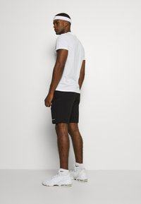 Champion - BERMUDA - Short de sport - black - 2