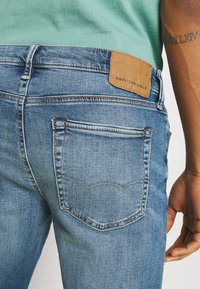 American Eagle - WASH - Jeans Slim Fit - faded light - 3