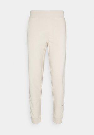 MELVIN PANTS UNISEX - Pantalon de survêtement - sandshell