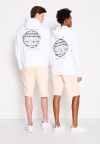 Tommy Hilfiger - ONE PLANET HOODY UNISEX - Sweatshirt - white - 2