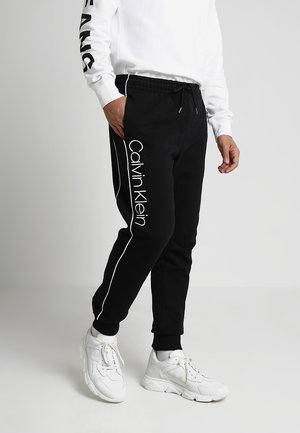 LOGO PRINT - Tracksuit bottoms - perfect black