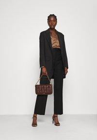 Hope - KEEN TROUSERS - Spodnie materiałowe - black - 1