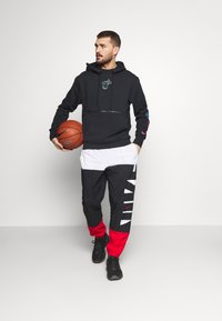 Nike Performance - STARTING PANT - Tracksuit bottoms - white/black/university red - 1