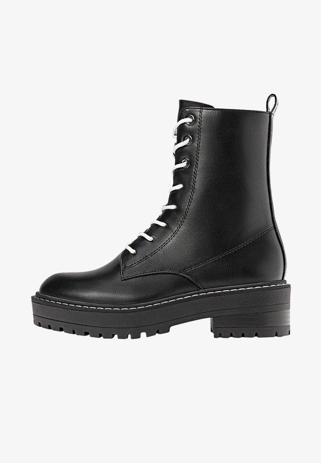 MIT SCHNÜRUNG - Veterboots - black