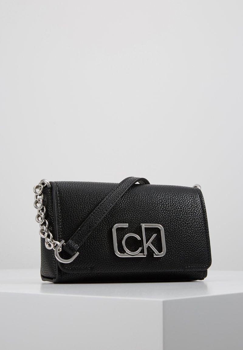 Calvin Klein - SIGNATURE FLAP XBODY - Across body bag - black