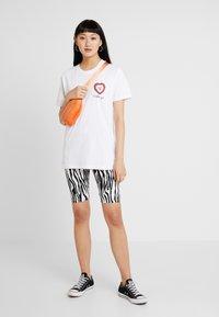 Merchcode - LADIES LIKE YOU TEE - Print T-shirt - white - 1