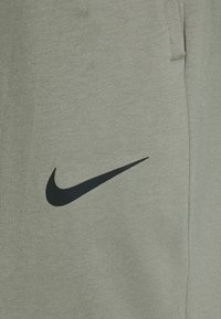 Nike Performance - PANT TAPER - Tracksuit bottoms - light army/black - 5