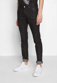 Just Cavalli - ANIMAL PATTERN PANTS 5 POCKETS - Jeans Slim Fit - black - 0