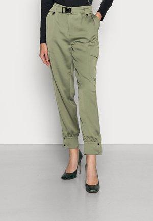 EMI PANTS - Cargo trousers - lichen leaf green