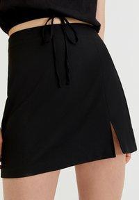 PULL&BEAR - MIT SCHLITZ - A-line skirt - black - 3