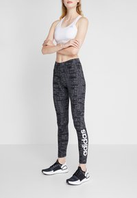 adidas Performance - ESSENTIALS SEASONAL SPORT LEGGINGS - Punčochy - black - 0