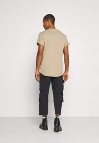 Another Influence - CARTER TROUSERS - Pantaloni - black - 2