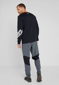 Under Armour - VANISH  - Teplákové kalhoty - pitch gray - 2