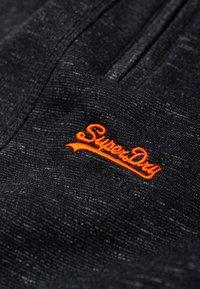 Superdry - ORANGE LABEL - Tracksuit bottoms - black - 4