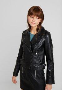 Vero Moda - VMCOOL SHORT COATED JACKET - Faux leather jacket - black - 0