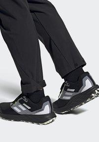 adidas Performance - TERREX TWO FLOW - Stabilty running shoes - savannah/core black/hi-res yellow - 7