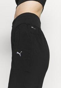 Puma - RUN FAVORITE TAPERED PANT - Pantalon de survêtement - black - 4