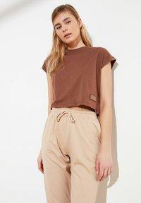 Trendyol - Tracksuit bottoms - brown - 3