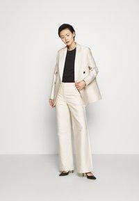 DESIGNERS REMIX - HAILEY FLARE - Trousers - cream - 1