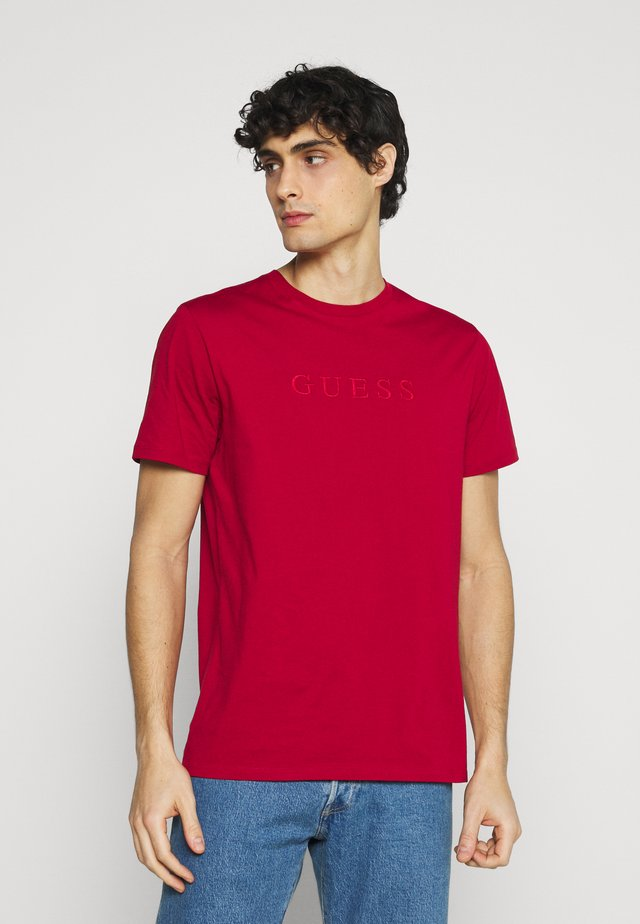 T-shirts med print - rouge chili