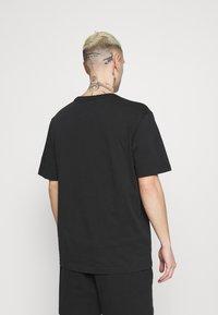 adidas Originals - BADGE UNISEX - T-Shirt basic - black - 2