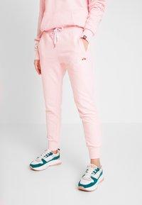 Ellesse - FRIVOLA - Tracksuit bottoms - light pink - 0