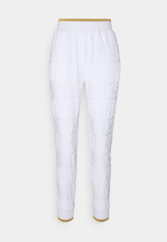INVERSE TRACK PANT - Pantalones deportivos - whiite