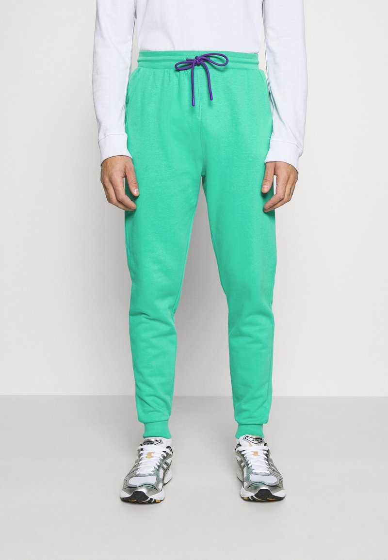 Urban Threads - COLOUR POP JOGGER UNISEX - Tracksuit bottoms - green