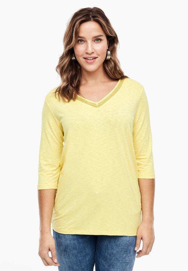 MIT SCHMUCK-DETAIL - Basic T-shirt - light yellow