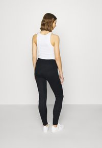 ONLY - ONLAUBREE LOOSE PANTS  - Tracksuit bottoms - dark navy - 2