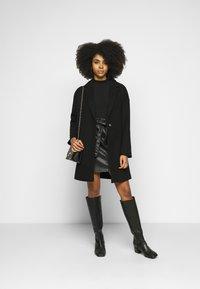 ONLY Petite - ONLRIGIE PAPER BAG SKIRT - Pencil skirt - black - 1
