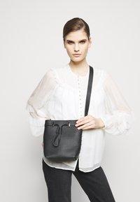 Furla - GIOVE MINI DRAWSTRING UNISEX - Across body bag - nero - 0