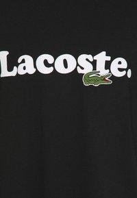 Lacoste - PLUS  - Print T-shirt - noir - 2