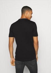 Calvin Klein - RINGER POCKET - T-shirt print - black - 2