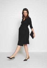 Cake Maternity - LONG SLEEVE WRAP DRESS - Vestito di maglina - black - 1