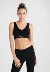 ONLY Play - ONPMIRA SEAMLESS BRA - Medium support sports bra - black - 0