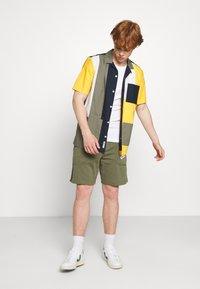 Nike Sportswear - AIR - Tracksuit bottoms - medium olive/cargo khaki/white - 1