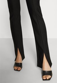 Gina Tricot - FRONT SLIT TROUSERS - Trousers - black - 3