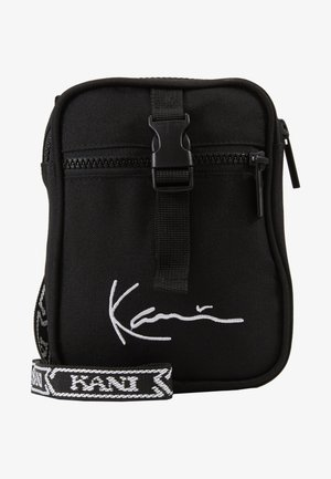SIGNATURE TAPE MESSENGER BAG - Across body bag - black/white