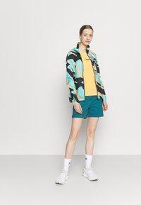 Dare 2B - MELODIC II SHORT - Sports shorts - dragonfly green - 1