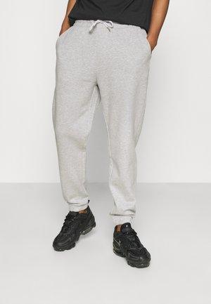 UNISEX - Tracksuit bottoms - mottled light grey
