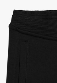 The North Face - PANT - Tracksuit bottoms - black/white - 2